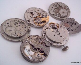 Lot of 6 Vintage watch movements for steam punk or jewelry. Lot 22.
