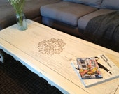 Shabby chic, cottage style, distressed, antique white coffee table with stenciled detail.