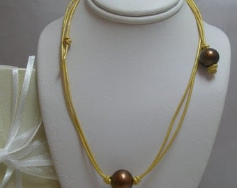 Chocolate Pearls on Golden metallic Leather with toggle clasp