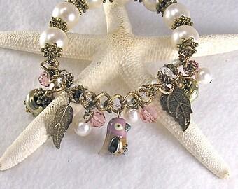 Kiki, Lampwork bird bracelet, Stretch bracelet, Charm bracelet, rose, pink, Pearl bracelet, Xanna's Jewelry Box