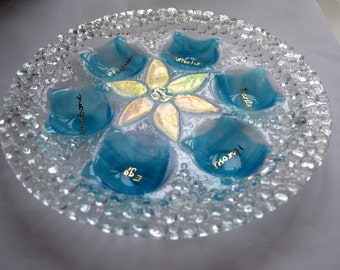 Clear diamonds glass fused Seder plate in light blue English lettering by YafitGlass