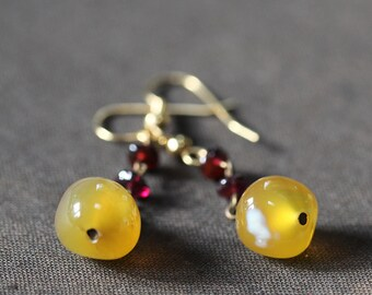 Vivid yellow agate and garnet earrings on antiqued brass