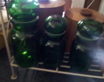 3 green apothecary jars
