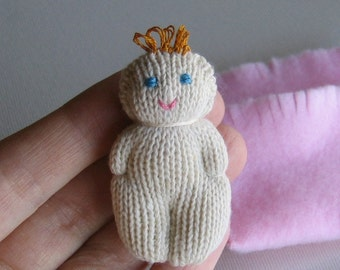Knit baby doll plush soft sculpture with fleece snuggle bag