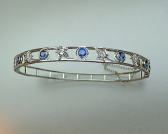 An Antique Platinum Bangle Bracelet Set with Blue Sapphires and Mine Cut Diamonds. (A879)