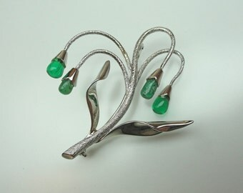 A Whimsical Weeping Willow-like Brooch made of 18K White Gold with Emerald drops. (A1230)