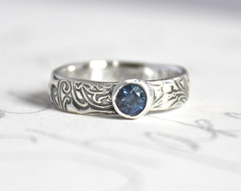 blue sapphire scroll engagement ring . ethical silver unique engagement ring . engraved message . made to order by peaces of indigo
