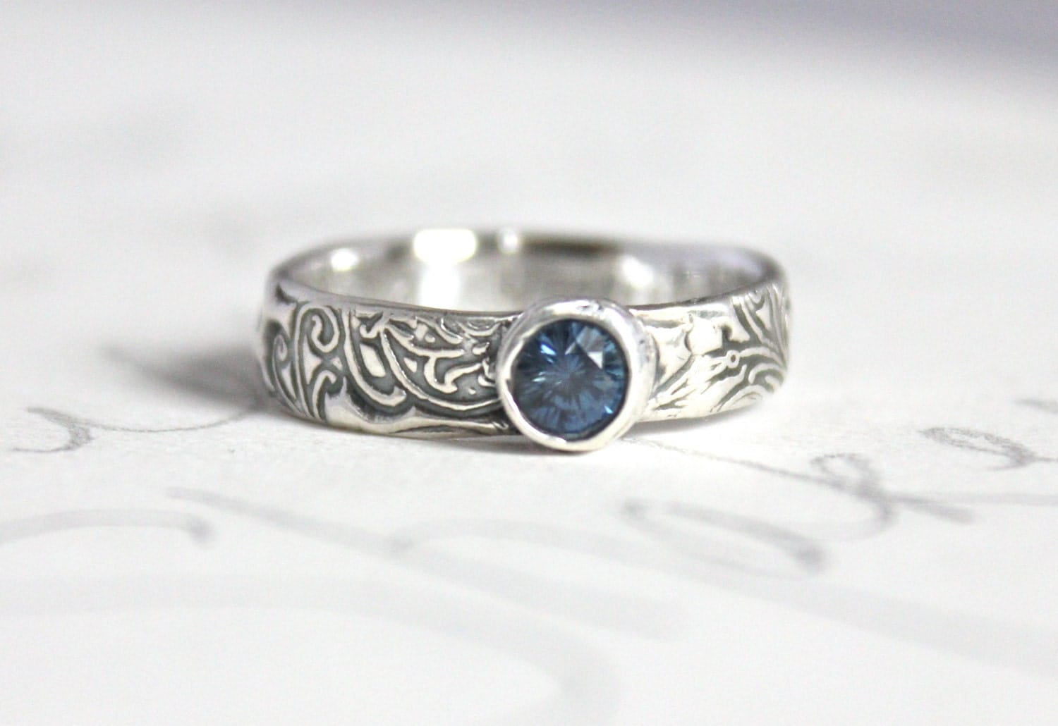 Blue sapphire scroll engagement ring ethical silver unique for Ethical wedding rings