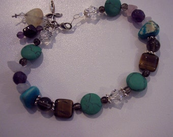 Multi stone bracelet with charms