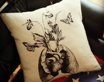 Growing Lungs cotton pillow black on natural sandstone canvas