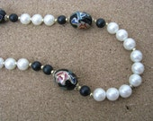Vintage white bead necklace decorated black bead cloisonne type accents marked Japan