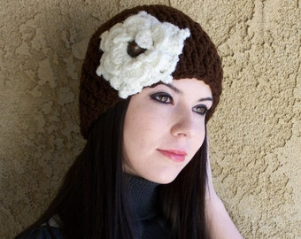 The Flapper style beanie comes with a large  flower