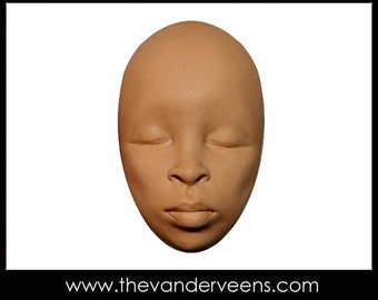 Mold No.47 (Face- African looking with closed eyes) by Veronica Jeong