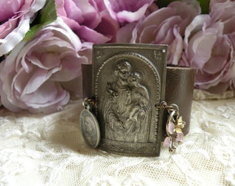 religious bracelet leather cuff assemblage catholic medal upcycled rustic unique ooak