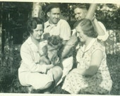 Men Women Sitting Looking Through Tree Holding Small Dog 1920s Summer Camp Day Vintage Photo Black and White Photograph
