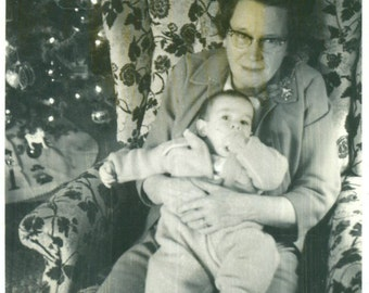 Great Grandmother Holding Baby Squirming in Chair By Christmas Tree 1950s Vintage Black White Photo Photograph