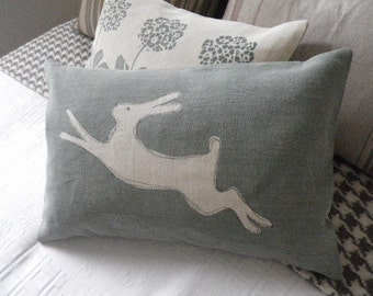 hand printed sage leaf blue leaping hare cushion cover