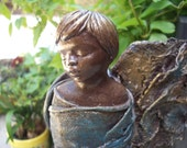 Contemporary  fabric angel boy sculpture for garden or home