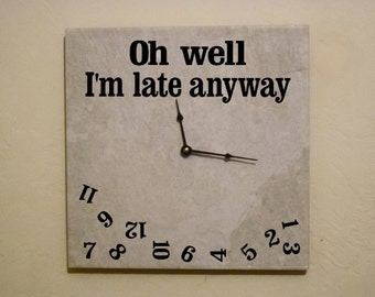 Funny ceramic wall clock saying I'm late