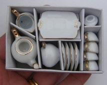 1 White and gold porcelain tea set