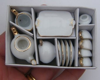1 White and gold porcelain tea set