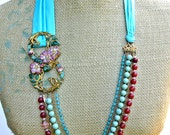 Entwined Flora- Long necklace with silk ties, Vintage Enameled buckle, and stone beads