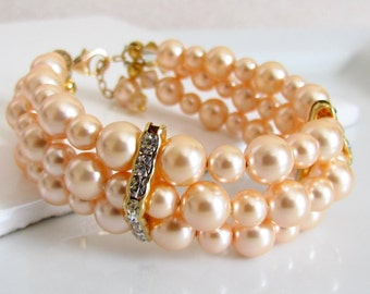 Peach Pearl Bracelet, Multi-Strand Pearl Bracelet, Three Strand, Wedding Pearl Cuff, Gold Bridal Jewelry, Peach Bridesmaids Jewelry