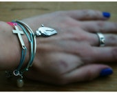 A Crossed Parrot, two stacking bracelets