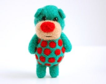 Green-ish Blue-ish felted pocket bear with red polka dots