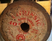 One large wooden spool of vintage heavy duty thread