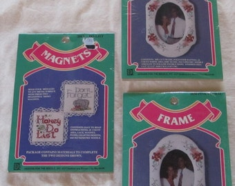 vintage CROSS STITCH KITS -- picture frames (2) and magnets (1)