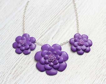 Necklace with purple leather flowers