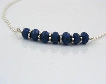 Dark blue gemstones on sterling silver chain necklace