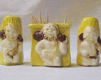vintage caveman salt, pepper and toothpick holder set