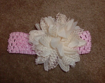Sweet crochet headband accented with a shabby chic ivory flower