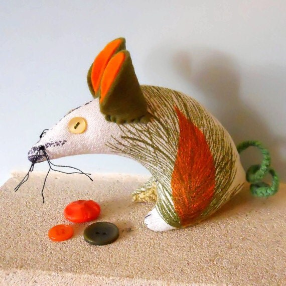 Retro mouse in a 60s vintage fabric  of  orange seed head barkcloth