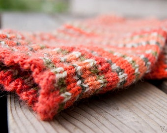 Hand knitted socks in warm wool blend yarn. Pumpkin orange, tangerine and green stripes.