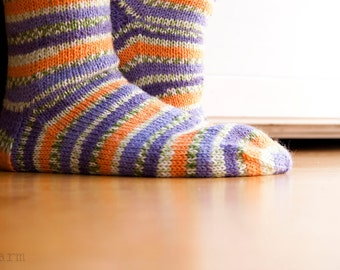 Hand knitted socks - wild pansy. stripes in blue, purple, orange and green.