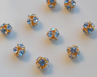 NEW GORGEOUS Set of  (12) Swarovski Crystal 5 MM Rounds in Gorgeous Lt. Sapphire Wholesale