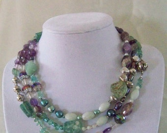 Playful purple accenting aqua long necklace with earrings