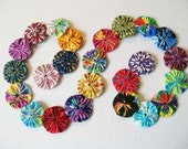 "3 Ft. Assorted Colors Yo Yo Garland Party Swag 1.5"" Yo Yos Photo Prop - SidelineQuilts"