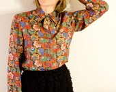 RESERVED FOR alice thompson SALE Medium 1970s Multi Colored Paisley Tie Collar Secretary Blouse