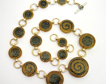 Statement Silver Necklace - sterling silver necklace - circles necklace - opulent necklace with golden spirals over grey