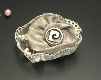 Brooch flower pin of textile fabric and vintage Pierre Cardin button