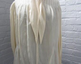 "Elegant vintage ivory silk ""secretary"" blouse with scarf tie neckline."
