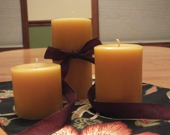 Set of Three pure beeswax pillar candles.  Perfect for centerpieces...