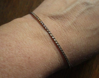 Vintage 1940s to 1960s Bangle Bracelet Cut Outs Sparkly Unusual Gold Tone Metal