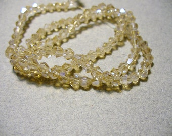 Crystal Beads Faceted Bicone Champagne AB 4MM