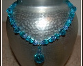 Turquoise/teal/blue glass pendant Necklace