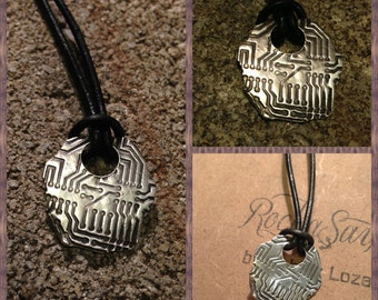 Fine silver and leather circuit board necklace.